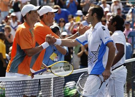 Bob and Mike (L) Bryan of the U.S. is congratulated by Leander Paes of India and Radek Stepanek of the Czech Republic after their men's doubles finals match at the U.S. Open tennis tournament in New York September 7, 2012. REUTERS/Kevin Lamarque