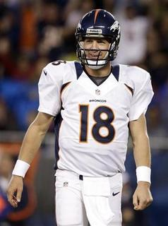 Peyton Manning of the Denver Broncos (18) reacts to giving up an interception while playing the Chicago Bears during the first quarter of their NFL pre-season game in Chicago, August 9, 2012. REUTERS/John Gress