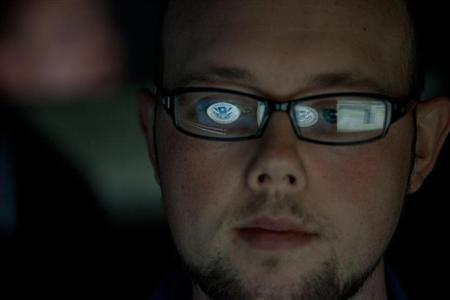 A cyber security analyst works in a watch and warning center at a Department of Homeland Security cyber security defense lab at the Idaho National Laboratory September 30, 2011. REUTERS/Jim Urquhart