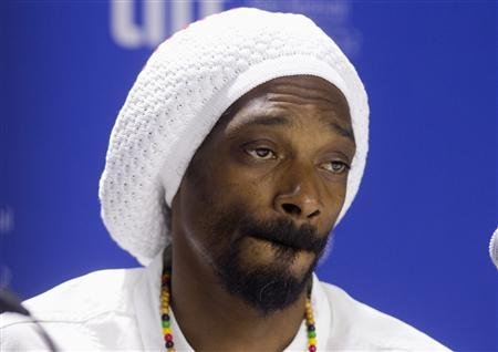 Rapper and actor Snoop Lion attends a news conference to promote the film ' Reincarnated ' during the 37th Toronto International Film Festival, September 7, 2012. REUTERS/Fred Thornhill
