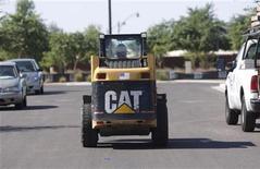 A worker drives a Caterpillar tractor near a construction site in Gilbert, Arizona October 20, 2009. REUTERS/Joshua Lott