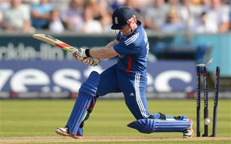 England's Eoin Morgan is bowled for 10 runs by South Africa's Johan Botha during the first Natwest T20 international cricket match at the Riverside ground, Chester-le-Street, England September 8, 2012. REUTERS/Philip Brown