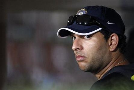 India's Yuvraj Singh walks out of the dressing room as the first Twenty20 international cricket match between India and New Zealand was been called off due to heavy rain in Visakhapatnam September 8, 2012. REUTERS/Vivek Prakash