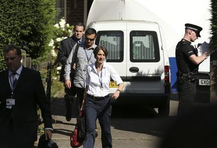 French and British police officers leave the leave the home of Saad al-Hilli in Claygate, south of London September 8, 2012. REUTERS/Olivia Harris