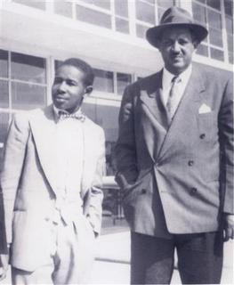 Paul Perkins, Jr. (L) welcomes Thurgood Marshall - who helped defend the Groveland Four - to Florida prior to the start of Walter Irving's retrial in Ocala, Florida, in this February 1952 handout photo. The families of the four young black men accused in the questionable 1949 rape claim of a white woman in the then-segregated American South, are asking Florida Governor Rick Scott to re-examine the evidence and clear the mens' names. REUTERS/Paul Perkins Jr./Handout.