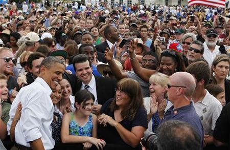 U.S. President Barack Obama poses with crowd members after speaking at a campaign event at Natural Habitat Park Field on the St. Petersburg College Seminole Campus in Florida September 8, 2012. REUTERS/Larry Downing