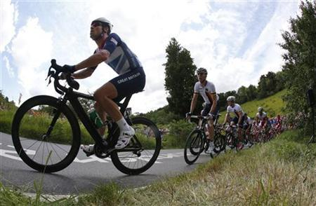Mark Cavendish of Britain races on the Box Hill circuit during the men's cycling road race at the London 2012 Olympic Games, July 28, 2012. REUTERS/Mark Blinch
