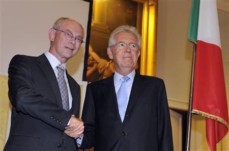 European Council President Herman Van Rompuy (L) shakes hand with Italy's Prime Minister Mario Monti during the Ambrosetti workshop in Cernobbio, next to Como, September 8, 2012. REUTERS/Paolo Bona