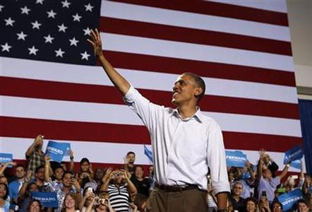 U.S. President Barack Obama waves at a campaign event at the Kissimmee Civic Center in Florida, September 8, 2012. REUTERS/Larry Downing