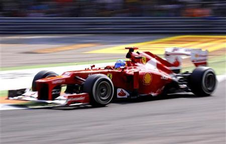 Ferrari Formula One driver Fernando Alonso of Spain drives his car during the qualifying session for the Italian F1 Grand Prix at the Monza circuit September 8, 2012. REUTERS/Giorgio Perottino