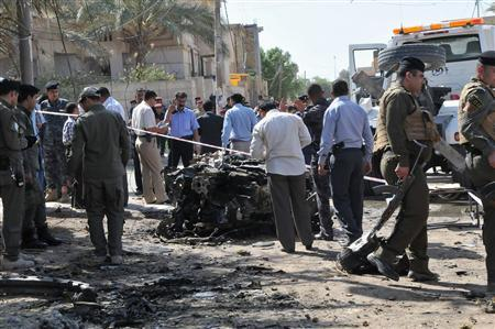 Iraqi security personnel inspect the site of a car bomb attack outside a French consular building in Nassiriya, 300 km (185 miles) south of Baghdad,September 9, 2012. One car bomb exploded outside the French consular building in the usually stable city of Nassiriya, south of Baghdad, wounding two people, police said. Another car bomb also detonated in the city, killing two and wounding three. REUTERS-Stringer