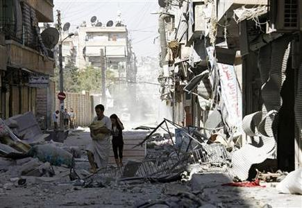 Residents inspect the damage caused by a jet air strike in Aleppo's district of Bustan al-Basha September 8, 2012. REUTERS/Zain Karam