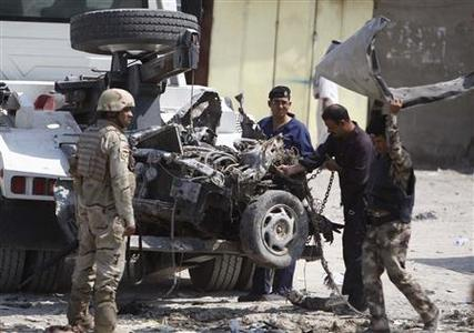 Iraqi security personnel inspect the site of a car bomb attack in Basra, 420 km (261 miles) southeast of Baghdad September 9, 2012. REUTERS/Atef Hassan