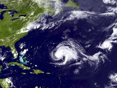 Hurricane Leslie (C) and Hurricane Michael (R) are seen in this NOAA handout satellite image taken September 6, 2012. REUTERS/NOAA/Handout