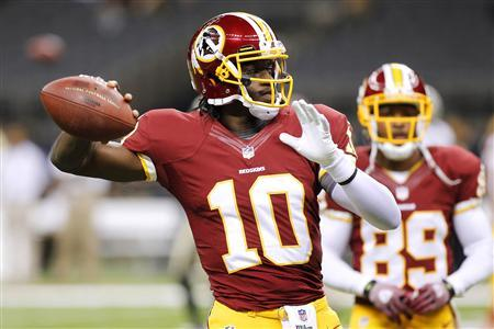 Washington Redskins quarterback Robert Griffin III (10) warms up before their NFL football game against the New Orleans Saints in New Orleans, Louisiana September 9, 2012. REUTERS/Jonathan Bachman