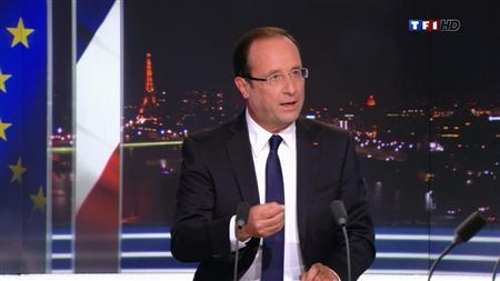 France's President Francois Hollande, seen in this video grab from French private TF1 television, speaks during a prime time news broadcast at their studios in Boulogne-Billancourt, near Paris, September 9, 2012. REUTERS/Handout
