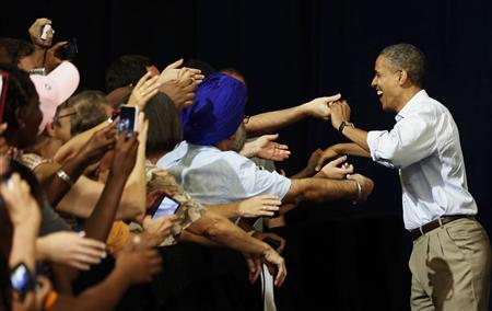 U.S. President Barack Obama shakes hands at a campaign event at the Florida Institute of Technology in Melbourne, Florida September 9, 2012. REUTERS/Larry Downing