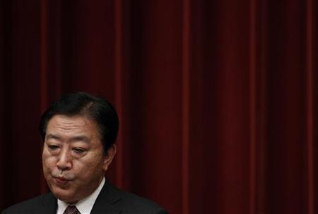 Japan's Prime Minister Yoshihiko Noda attends at a news conference at his official residence in Tokyo September 7, 2012. REUTERS/Issei Kato