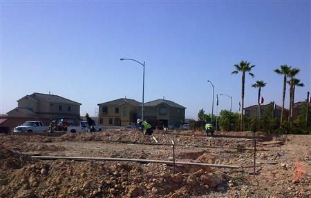 Workers prepare a plot of land in Las Vegas in May, 2012. REUTERS/Katya Wachtel