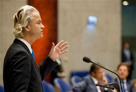 Anti-immigration politician Geert Wilders speaks during a debate at the Dutch parliament about the government's resignation caused by a crisis over budget cuts in The Hague April 24, 2012. REUTERS/Robin van Lonkhuijsen/United Photos/Files