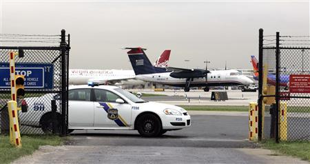 A Philadelphia Police vehicle blocks the entrance to Gate 11 where a US Airways plane was searched after being ordered back to Philadelphia International Airport following a report of explosives onboard, in Philadelphia September 6, 2012. REUTERS/Tom Mihalek