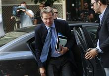 International Monetary Fund's (IMF) Deputy Director and Mission Chief to Greece Poul Thomsen (C) arrives at the Finance Ministry for a meeting in Athens September 9, 2012. REUTERS/John Kolesidis