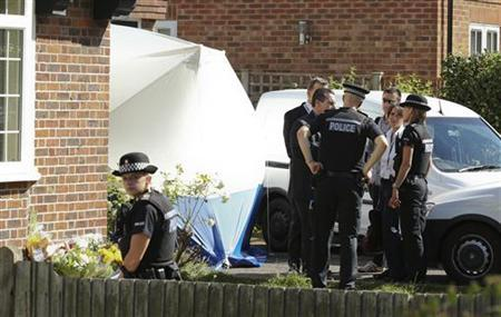 French police officers speak with their British counterparts as they arrive at the home of Saad al-Hilli in Claygate, south of London September 8, 2012. REUTERS/Olivia Harris