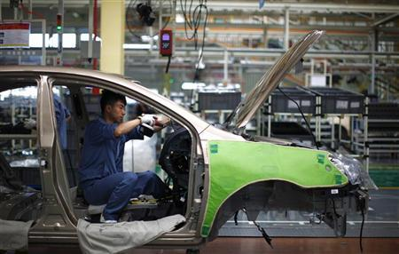 An employee works on the interior of a car along a Geely Automobile Corporation assembly line in Cixi, Zhejiang province June 21, 2012. REUTERS/Carlos Barria