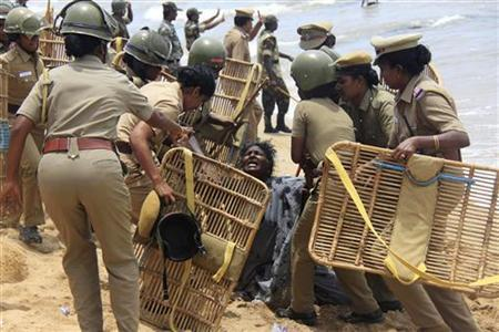 Police detain a demonstrator during a protest near a nuclear power project in Kudankulam in Tamil Nadu September 10, 2012. REUTERS/Stringer