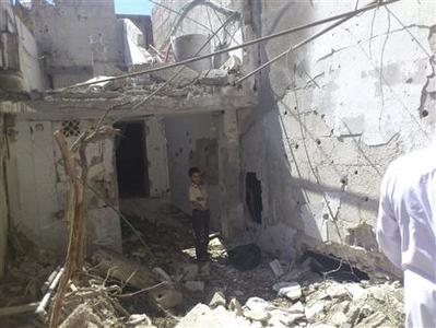 A boy looks at a damaged house at Sayeda Zainab area in Damascus September 8, 2012, Picture taken September 8, 2012. REUTERS/Shaam News Network/Handout