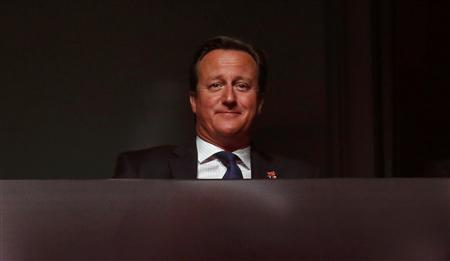 Britain's Prime Minister David Cameron sits in the Olympic Stadium during the closing ceremony of the London 2012 Paralympic Games September 9, 2012. REUTERS/Suzanne Plunkett