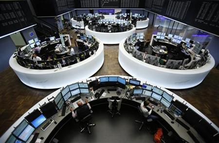 Traders works at their desks at the Frankfurt stock exchange September 6, 2012. REUTERS/Alex Domanski