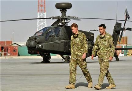 Britain's Prince Harry is shown the Apache helicopter flight line by an unidentified member of his squadron at Camp Bastion, Afghanistan September 7, 2012. REUTER/John Stillwell/POOL