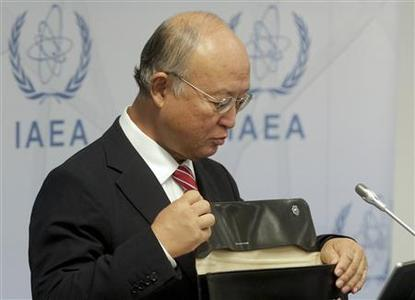 International Atomic Energy Agency (IAEA) Director General Yukiya Amano opens his case as he attends a news conference during a board of governors meeting at the United Nations headquarters in Vienna September 10, 2012. The U.N. nuclear watchdog chief pressed Iran on Monday to grant his inspectors immediate access to the Parchin military site, where they believe Tehran may have conducted explosives tests relevant to the development of nuclear weapons. REUTERS/Herwig Prammer