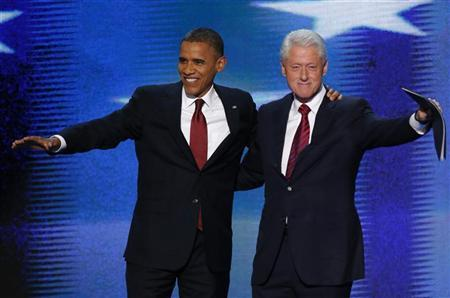 U.S. President Barack Obama (L) joins former President Bill Clinton onstage after Clinton nominated Obama for re-election during the second session of the Democratic National Convention in Charlotte, North Carolina, September 5, 2012. REUTERS/Jason Reed