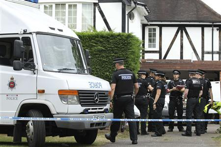 Police Officers stand outside the home of Saad al-Hilli in Claygate, south of London September 10, 2012. REUTERS/Olivia Harris