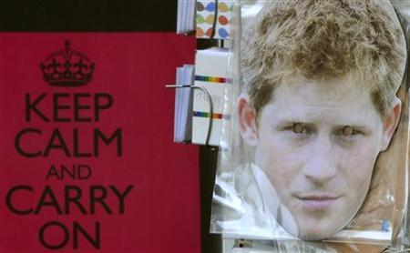 A souvenir shop displays a facemask of Britain's Prince Harry in London August 24, 2012. REUTERS/Toby Melville/Files