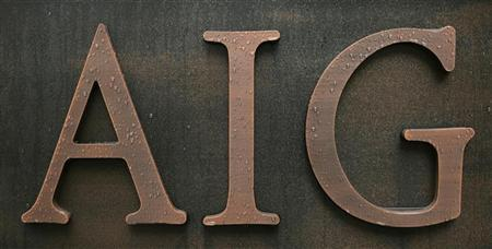 Raindrops are seen on an AIG logo at the AIG Building in Tokyo February 27, 2009. REUTERS/Michael Caronna
