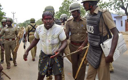 Police detain a demonstrator near a nuclear power project during a protest in Kudankulam, in the southern Indian state of Tamil Nadu, September 10, 2012. REUTERS/Stringer