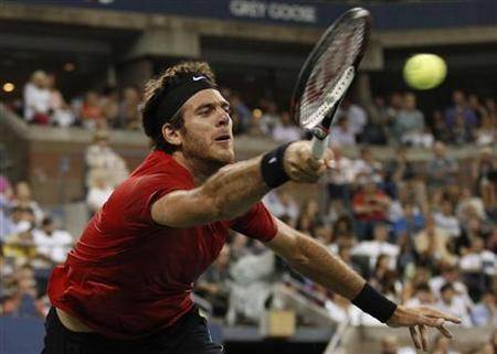 Juan Martin Del Potro of Argentina returns to Novak Djokovic of Serbia during their men's singles quarterfinals match at the U.S. Open tennis tournament in New York, September 6, 2012. REUTERS/Adam Hunger