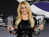 Singer Britney Spears poses with her award for Best Pop Video and the Michael Jackson Video Vanguard Award at the 2011 MTV Video Music Awards in Los Angeles August 28, 2011. REUTERS/Danny Moloshok