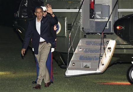 U.S. President Barack Obama waves as he walks on the South Lawn of the White House upon his return from Florida to Washington September 9, 2012. REUTERS/Yuri Gripas