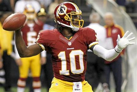 Washington Redskins quarterback Robert Griffin III (10) drops back to pass as his team takes on the New Orleans Saints during their NFL football game in New Orleans, Louisiana September 9, 2012. REUTERS/Jonathan Bachman