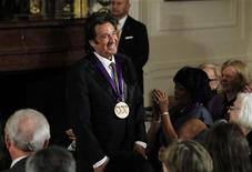 National Medal of Arts recipient, actor Al Pacino acknowledges the applause after receiving the medal from U.S. President Barack Obama at a ceremony in the East Room of the White House in Washington, February 13, 2012. REUTERS/Jason Reed