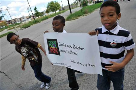 Schoolchildren, from left, Labaron Scott, 10, Jalen Reed, 9, and Christian Robinson, 9, are among the supporters of Chicago teachers during a march in advance of a possible strike in Chicago September 9, 2012. Some 29,000 teachers and support staff have threatened to strike on Monday, setting up an awkward confrontation between Mayor Rahm Emanuel, President Barack Obama's former top White House aide, and organized labor in the president's home city. REUTERS/Jean Lachat