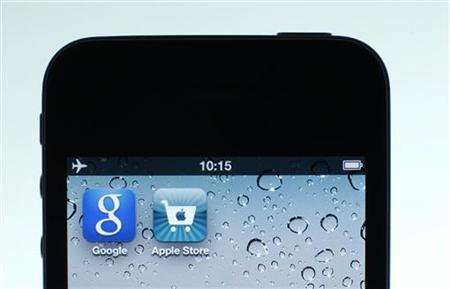 Google and Apple applications are seen on the display of IPhone in this photo illustration taken in Berlin, August 31, 2012. REUTERS/Pawel Kopczynski