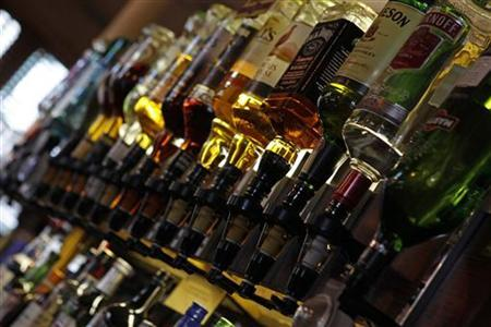 Bottles of alcohol are seen at The Lord Cardigan pub in east London January 26, 2012. REUTERS/Eddie Keogh/Files