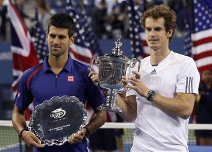 Britain's Andy Murray (R) and Serbia's Novak Djokovic hold their trophies after Murray defeated Djokovic in the men's singles final match at the U.S. Open tennis tournament in New York, September 10, 2012. REUTERS/Kevin Lamarque