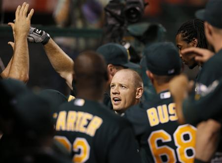 Oakland Athletics Brandon Moss celebrates after hitting a home run against the Los Angeles Angels during the fifth inning of their MLB American League baseball game in Anaheim, California September 10, 2012. REUTERS/Lucy Nicholson