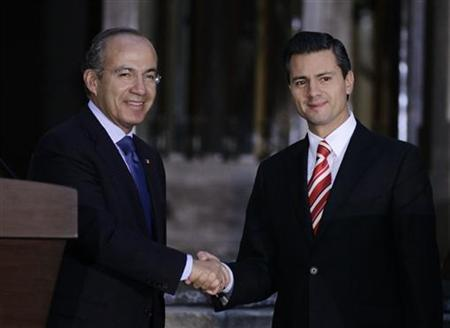 Mexican President Felipe Calderon (L) shakes hands with President-elect Enrique Pena Nieto after attending a private meeting at Los Pinos Presidential Palace in Mexico City September 5, 2012. REUTERS/Henry Romero